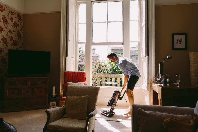 Matt vacuuming before leaving for the wedding at Berkeley Castle