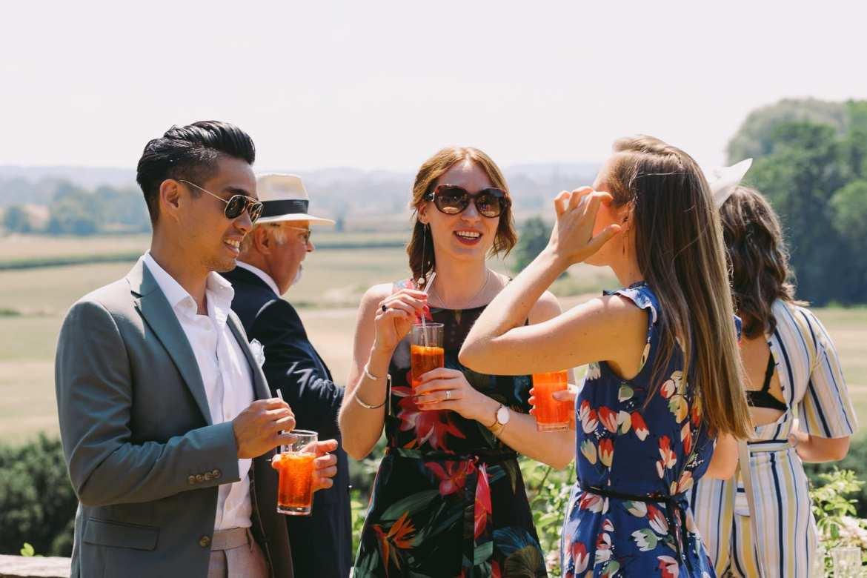 Wedding guests enjoying the sunshine on the gun terrace