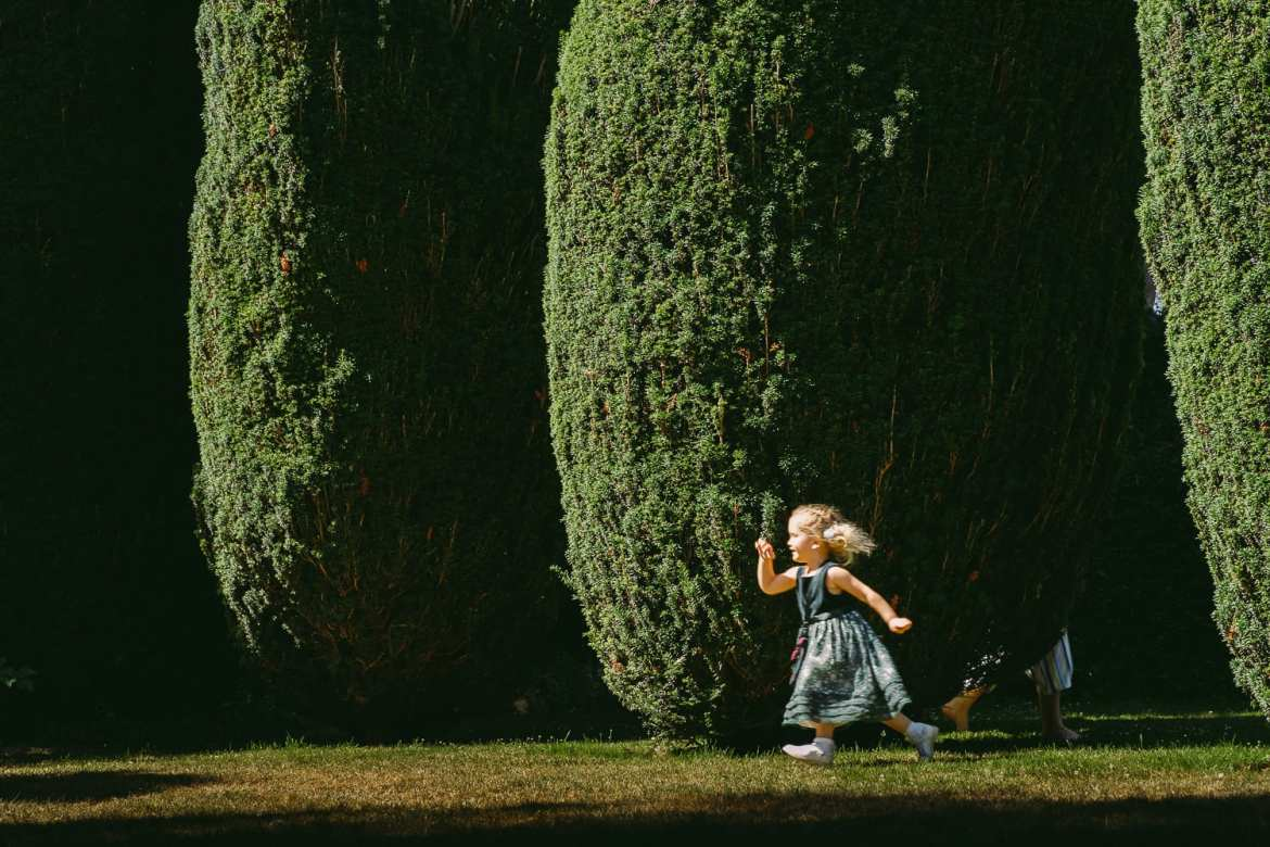 A child runs through the garden at Berkeley Castle