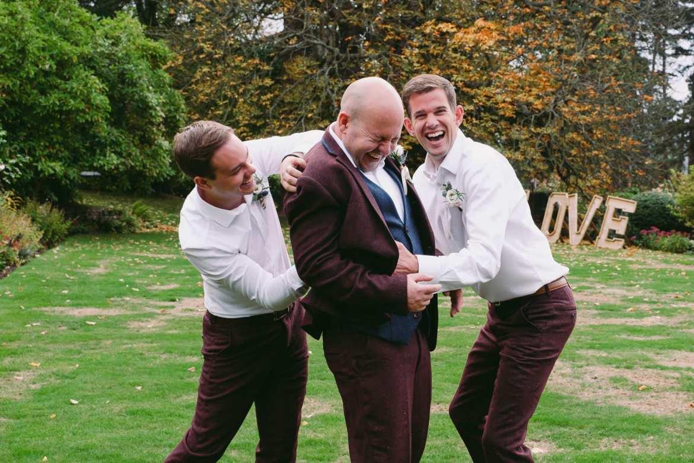 Groom being tickled by his best men