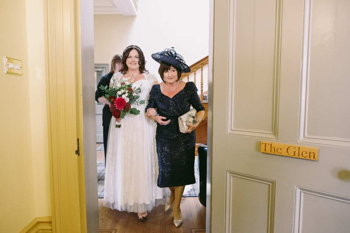 Bride entering the ceremony room with her mother