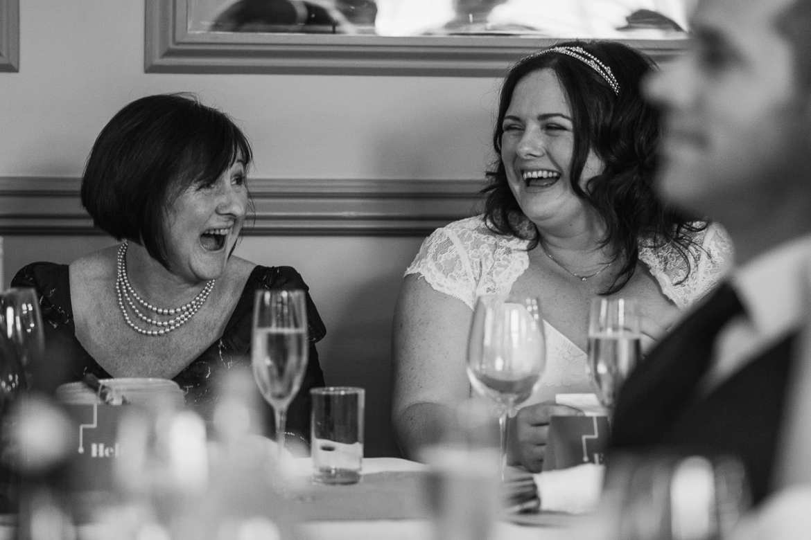 Bride and her mother laughing during speeches
