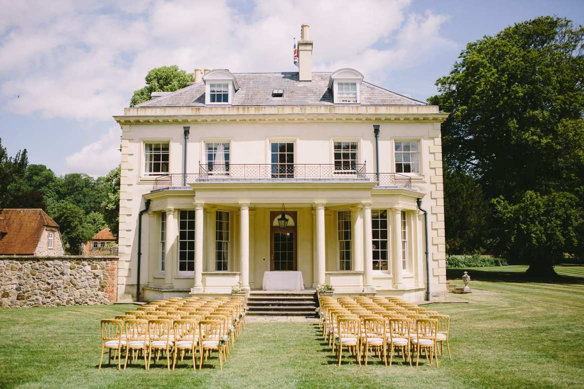 An outdoor wedding ceremony is set up on the portico at Rockley Manor
