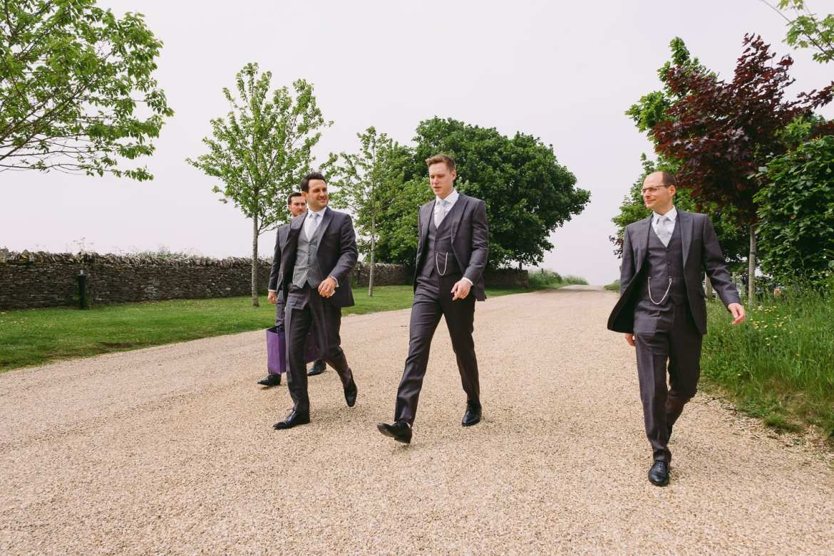 The groom and best men arrive at Stone Barn