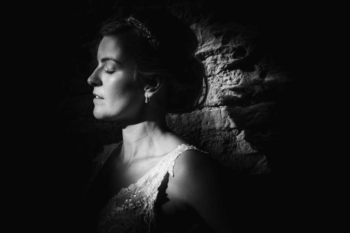 A portrait of the bride in a shaft of light