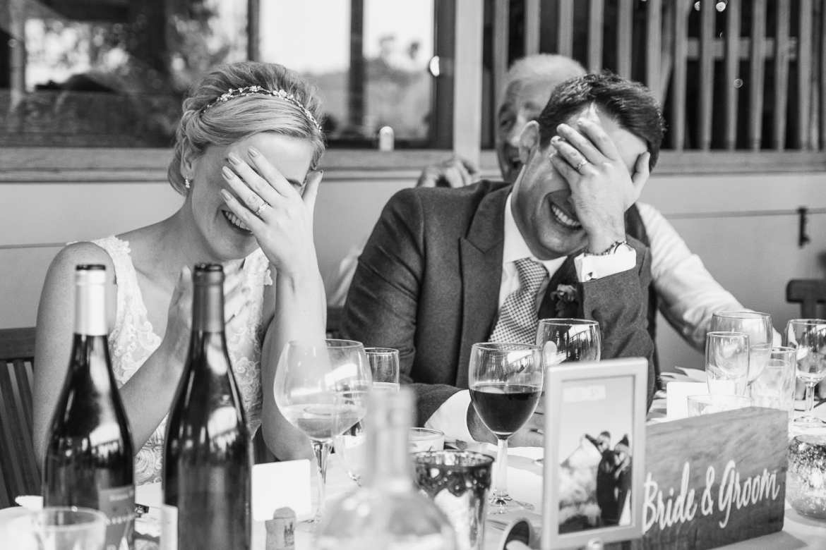 The newlyweds hide their faces during the best men's speech