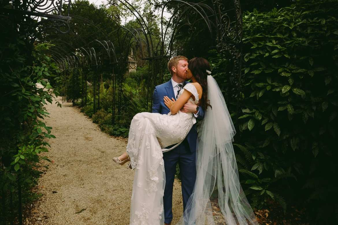 Newlyweds kiss in the garden