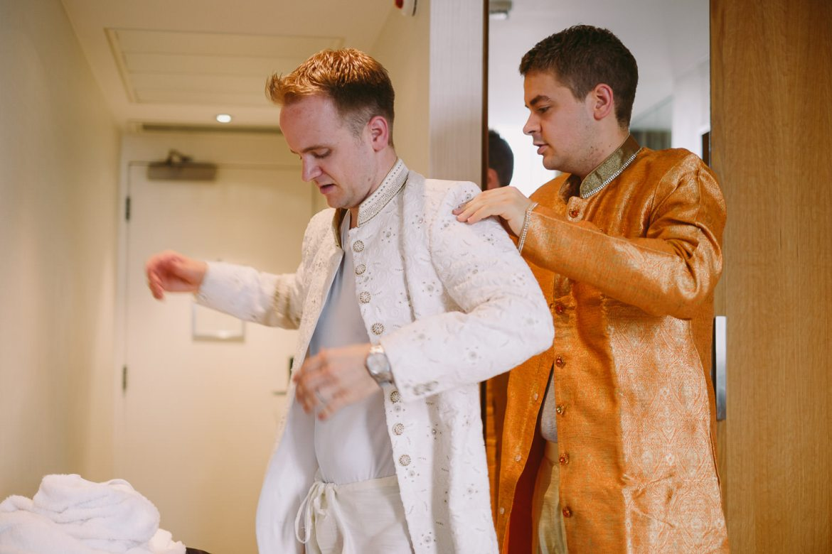 Groom and his brother getting into their Indian robes