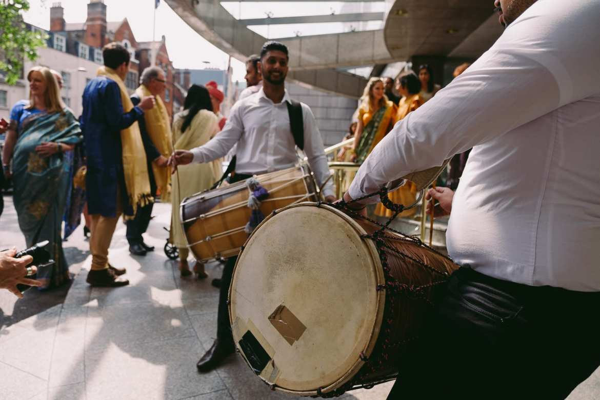 Indian Dhol drummers await the arrival of the groom