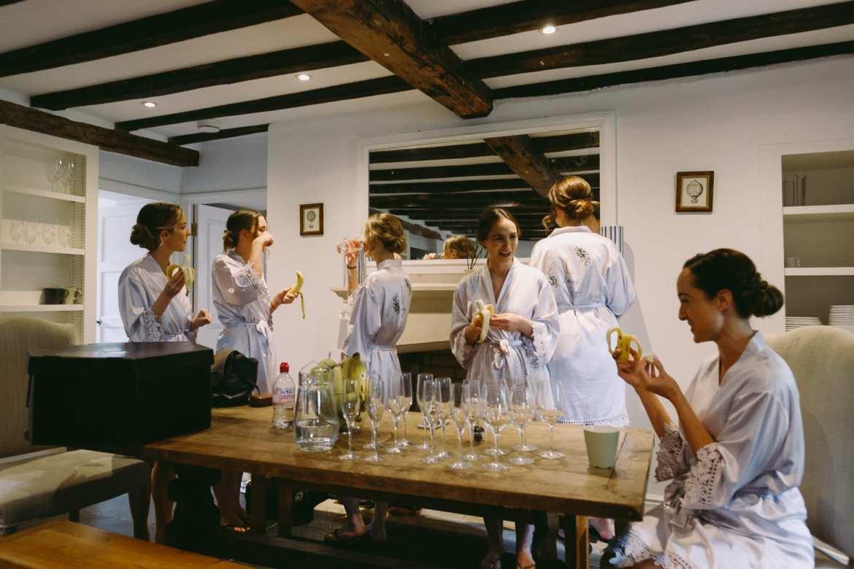 The bride and bridesmaids eating bananas