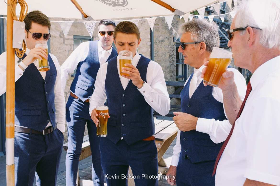 groom drinks a pint