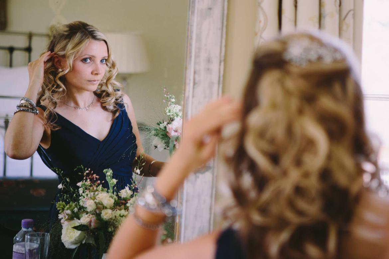 bridesmaid checks her hair