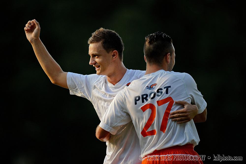 Clayton State University midfielder Elliott Prost and Ado Junuzovic celebrate a goal.