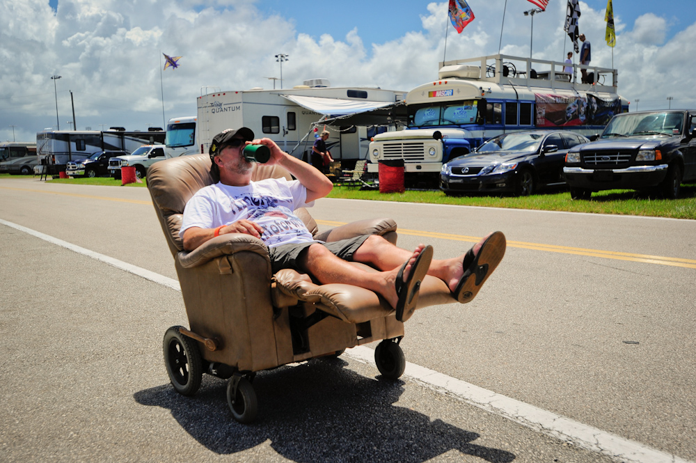 Ken Hochard from Palm Bay, Florida, cruises down the infield in his homemade motorized recliner prior at Daytona International Speedway prior to the start of the NASCAR Sprint Cup Series Coke Zero 400.