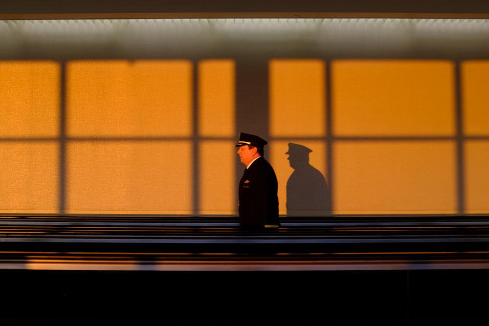 Pilot walks through airport