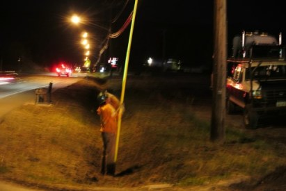 A Hydro worker turns on power again on Voght street.
