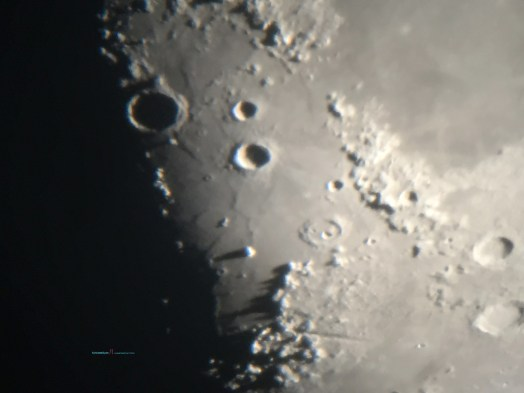 First Quarter Moon looking closer you'll see some interesting crater shadow in the Mare Iridium basin..