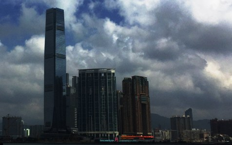West Kowloon - built on reclamation land hiding behind the backdrop is Lion Rock Mountain..