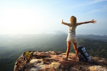woman-on-top-of-mountain-summit-2