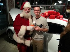 Not all Santa's are created equal. This one likes Tesla and Scotch!