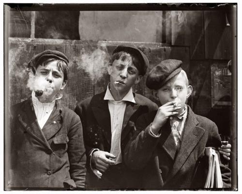 Newsboys smoking.