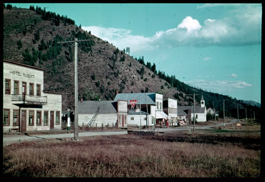 Alberton in 1973 hadn't changed much from Alberton in 1938, shown here. The interstate highway took travelers out of town, the railroad brought some back, and old houses went dark early.