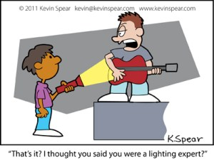 "Cartoon of a boy with a guitar and a boy with a flashlight. The Guitar player says, ""That's it? I thought you said you were a lighting expert?"""