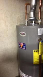 expert-plumber-installs-and-repairs-water-heaters