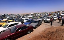Iraqis fleeing by car outside the city of Arbil, the capital of the autonomous Kurdish region. June 10, 2014. Source: Der Spiegel.
