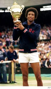Arthur Ashe with his Wimbledon trophy circa 1975
