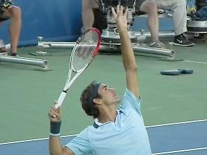 Roger Federer's trophy pose.