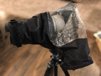 This dslr rain cover comfortably covers large camera rigs.