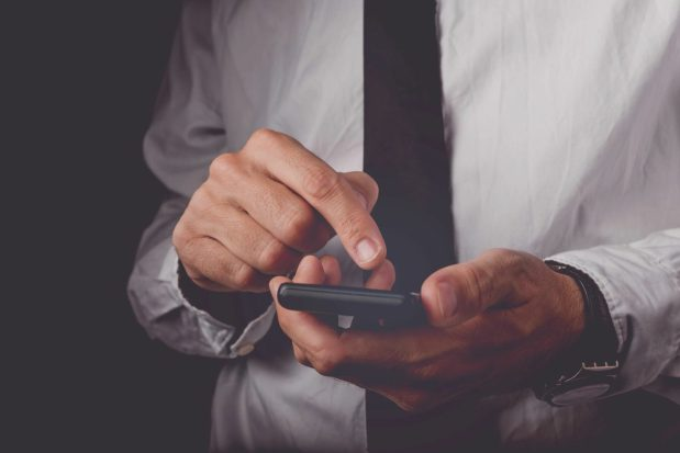 Stock photo of a business man using a smartphone