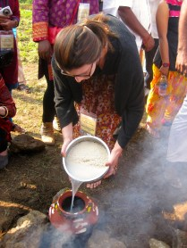 Filling the pot with the water in which the rice had been soaking.