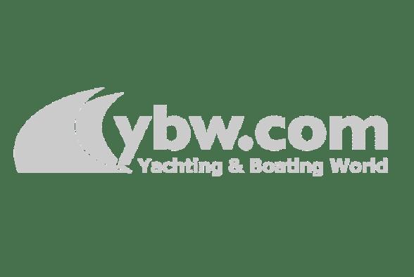 man on jetski driving by sailing yacht a