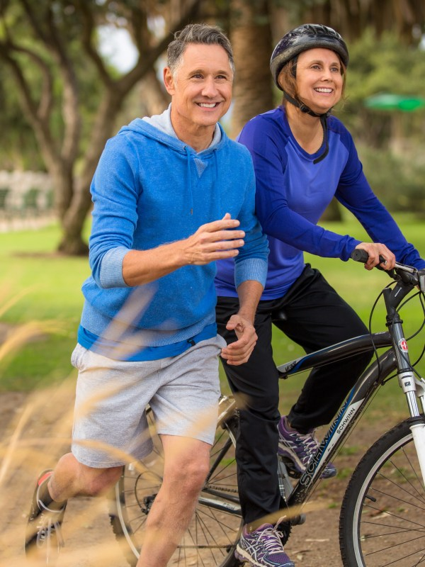 Elder couple exercising in the park