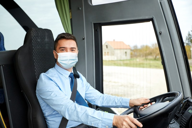 A bus driver wearing a protective face mask