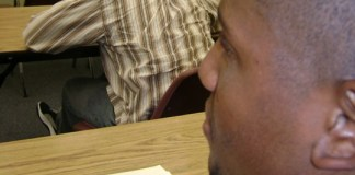 A man sitting on a table - Human behavior