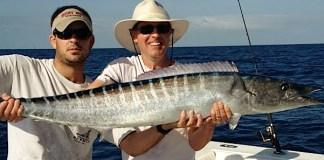A man holding a fish - Big-game fishing