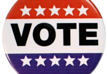 A close up of a sign - Politics