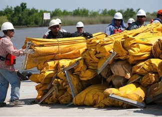 A group of people on a raft - Deepwater Horizon oil spill