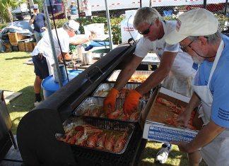 A man preparing food inside of it - Car