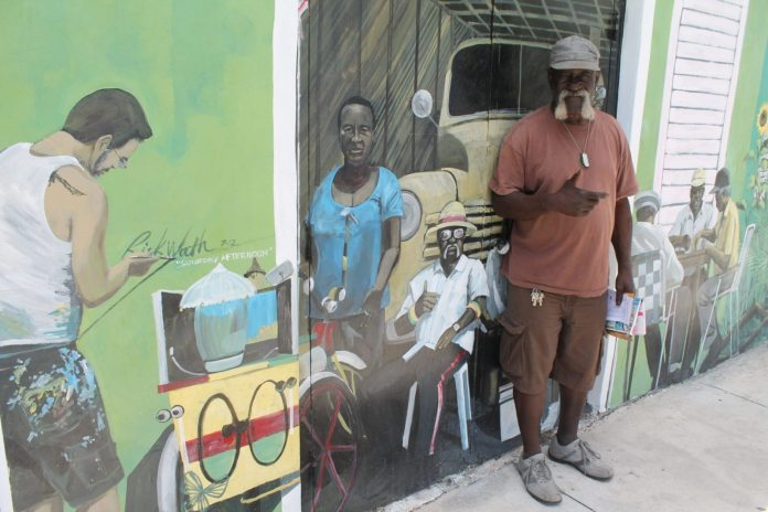 #Entertainment: James Chapman elevates character to art form - A group of people standing around each other - Painting