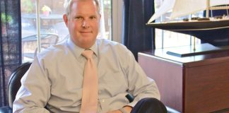#News: Pete Chapman named chairman of the board - A person sitting in a chair in front of a window - Business