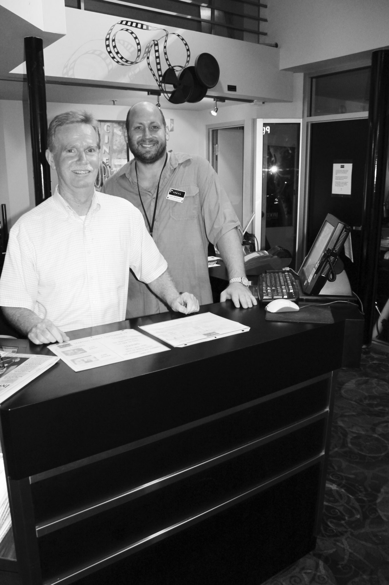 John Parce and Tropic Cinema Manager John Abramson greet folks as they enter the theater.