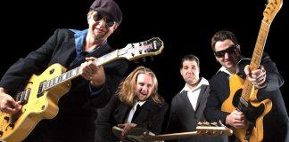 #News: International Blues Challenge Winner J.P. Soars returned to Green Parrot - A man holding a guitar - Mali Music