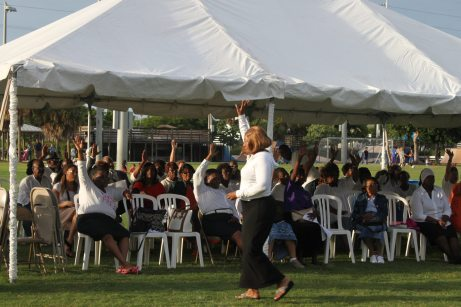 The audience raises their hands in praise at the Marathon Community Park.