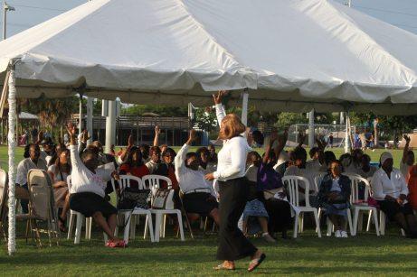 The audience raises their hands in praise at the Marathon Community Park.