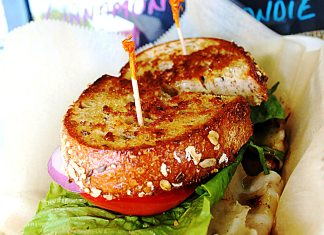 #Eat: New to-go spot has mouthwatering BBQ - A close up of a sandwich on a plate - Hamburger
