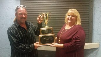Coldwell Banker Schmitt's Tina Masters, joined by husband Marc, celebrates the honor of being named the 2014 Key West Realtor of the Year.